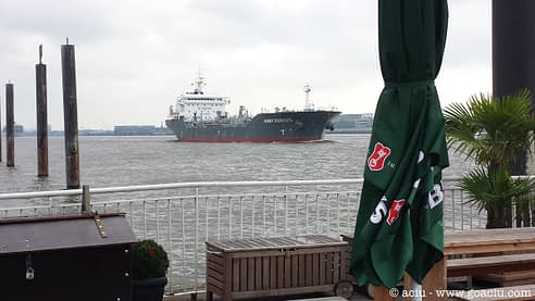 Watching ship go by from a cafe in Hamburg